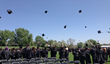 Colorado Connections Academy's 2014 graduates throw their caps in celebration.