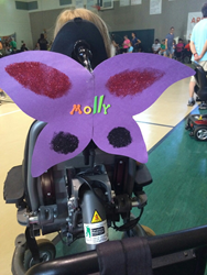 Molly, a camper at MDA summer camp, sports her shimmering butterfly wings