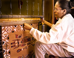 Marilyn Patiyamo finishing a Yeibichai rug, which took a year to make.