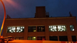 Areaware's neon eyes as seen from street level in Williamsburg, NY