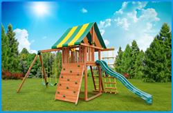 Cedar wooden swing set with slide swings rock climbing wall swing set raffle Best in Backyards Ty Louis Campbell Foundation