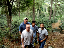 Dave Eldridge and Greg Ubert from Crimson Cup pose with coffee farmers at Honduran coffee plantation