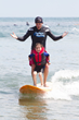 Surfers Healing Volunteer Surf Coach Lighting Up A Child's Life