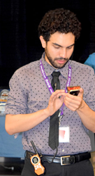 Young Man Messaging on his Smartphone