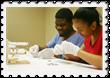 Students in Easter Seals School-to-Life transition program assembling ElyseRyan bracelets