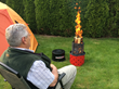 man sitting in front of campfire, campfire in a can, wood campfire, wood camp fire in a can, camping fire, backyard fire