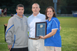 2014 Abraham Award presented to Hendrick Hudson HS AT Meg Greiner (right) and AD Tom Baker (left) by NYSATA Treasurer, Dave Byrnes.