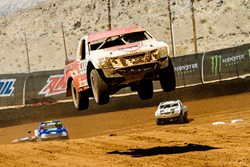 TORC trucks fly as high as 150 feet in the air as they race over bumps and moguls on the dirt track.