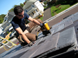 Contractor Mark Clement installs DaVinci Roofscapes polymer slate roofing tiles.
