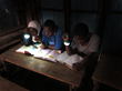Students in Liberia study under Nokero solar lights to avoid using dangerous kerosene fuel lamps.