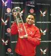 Vernon Adams lifts the CFPA Trophy