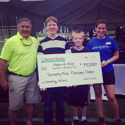 A Harris Teeter associate presents the Company's $75,000 donation to Make-A-Wish Central & Western North Carolina.