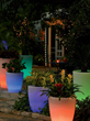 Solar illuminated planters can help light up your garden party at night.