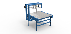 Conveyor device easily turns corrugated box bundles for cross strapping.