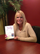 Lyn Hogrefe with copy of her book. (Photo Provided)