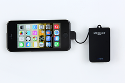 Megalo Mini charging an iPhone