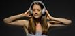 Nicole is wearing headphones that match her dress
