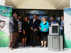 Local leaders and HOPE staff cut the ribbon at the credit union's new branch in Terry, Mississippi.