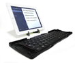 Amigo connects to iPad / tablet via Bluetooth, includes compact folding stand