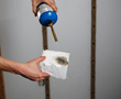 Flame is applied to a piece of USA Premium Foam. USA Premium Foam has a Class 1 Fire rating. It prevents or significantly delays the spread of  flames in the home.