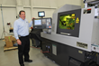 IMG Laser Product Manager Dale White with Swiss Laser