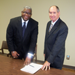 Dr. Sizer and Larry Donner sign a memorandum of agreement