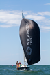 "Wilmington Trust will award the ""leader spinnaker"" to the winning boat in each day's heat for the J/105 fleet."