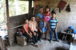 A humble family inside their home in Guatemala