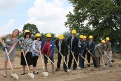 The staff of Lynnewood Gardens and Jersey Central Management break ground at the site of a new 10,000-square-foot community center.