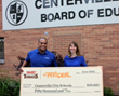 Keith Weaver, Lamb Weston representative, is pictured presenting a $50,000 check to Stephanie Zinger, foodservice director at Centerville City Schools in Ohio.