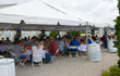 "Guests enjoy the barbecue at Indiana Limestone Company's ""Rock 'n' Quarry"" celebration."