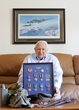 Gerard J. Caporaso, 93, of Summit, New Jersey, shows his World War II memorabilia and military medals.He recently published  From the Top Turret: A Memoir of  World War II and the American Dream.
