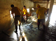 Scientology Volunteer Ministers in their bright yellow T-shirts cleaning out the barn of a farm in Kopanica in Bosnia and Herzegovina in June 2014.