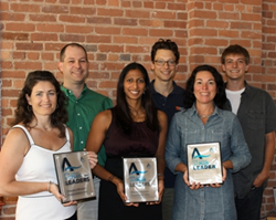 The SWA HERS team with their Indoor airPLUS awards from 2012, 2013, and 2014.