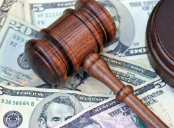 A gavel placed on top of U.S. cash