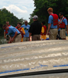 Participants at the 2013 Adventure Team Challenge Washington DC ready a canoe for the canal.