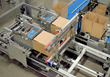 Patent pending loading cells with moving bottom and back smoothly transport products into cases for highly consistent pack patterns