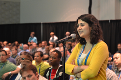 Seventeen plenary talks are among highlights in the program of the upcoming SPIE Optics + Photonics; above, an audience members poses a question during the 2013 event.