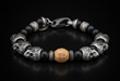 Onyx & sterling silver bracelet with fossil walrus tusk bead.