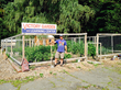 """Owner Robert Burke in the """"Victory Garden"""" on the property at Wayne Auto Spa, Wayne, New Jersey."""