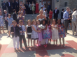 Kim Lane Ruef surrounded by her first grade students from Nishuane Elementary School in Montclair NJ.