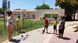 Children in Israel play outside with their new toys from Spin Master