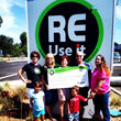 ReUseIt.org Presenting Fundraising Check to Nonprofit Partner