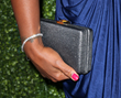Jill Milan's Art Deco Clutch, carried by Laila Ali to HollyRod Foundation's DesignCare event, Jul 19, 2014 in Los Angeles (Photo: David Livingston, Getty Images)