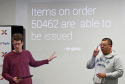 Developer Travis Webb and intern Stanley Zheng demonstrate xTuple for Google Glass
