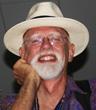John W. Travis, MD