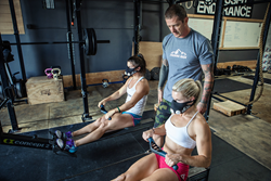 Brian MacKenzie coaches CrossFit athletes Danielle Horan and Libby DiBiase through a breathing protocol using Training Mask 2.0