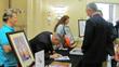 Ciancaglini signs autographs following his keynote address to help raise funds for BIANYS programming.