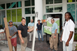 Members of the Habitat for Humanity of Greater Miami team collect donated building materials from The Modern Miami Apartments, a luxury rental high rise in downtown Miami owned by Chicago-based Watert