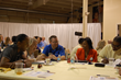 Participants engage in a roundtable discussion on expressing faith at work. (Memories Matter Photo)